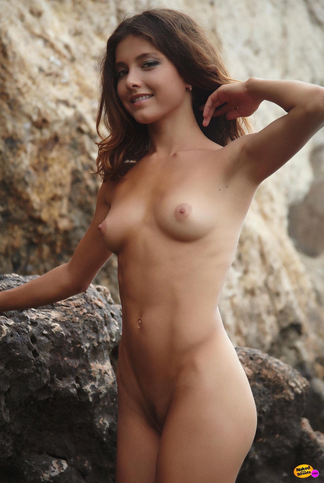 Sexy girl posing naked at the beach - NakedOnTheStreets.com