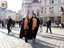 Two girls in the middle of a city square show us what's under their coats!