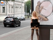 Classy girl flashing pussy in front of chanel sign