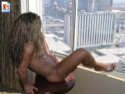 Woman masturbating in front of window