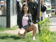 Cheeky girl shows upskirt near busy bus stop